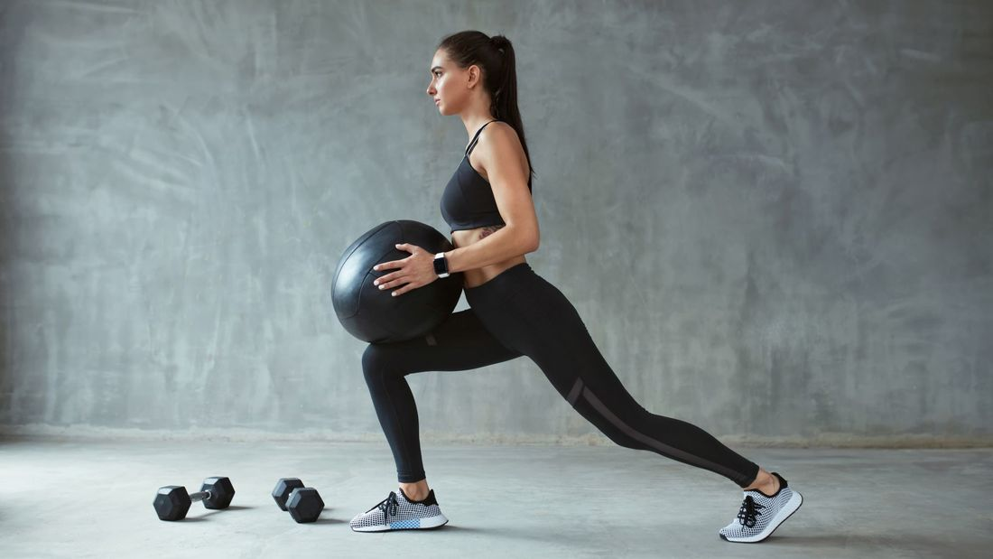 Woman,In,Stylish,Sports,Wear,Training,With,Med,Ball