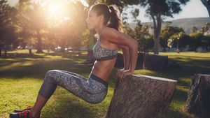 Young,Woman,Practicing,Push,Ups,In,A,Park.,Side,View